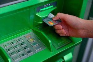 Через банкомат Сбербанка